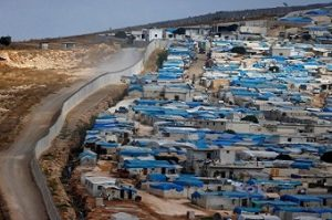 FILE PHOTO: Wall along the border between Turkey and Syria is pictured at the Syrian town of Atimah