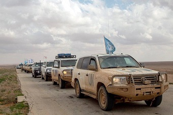 UN humanitarian convoy protected by Russian military arrives from refugee camp to Homs, Syria