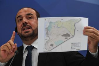 Syrian opposition signals willingness to stand in elections. What does it mean?
